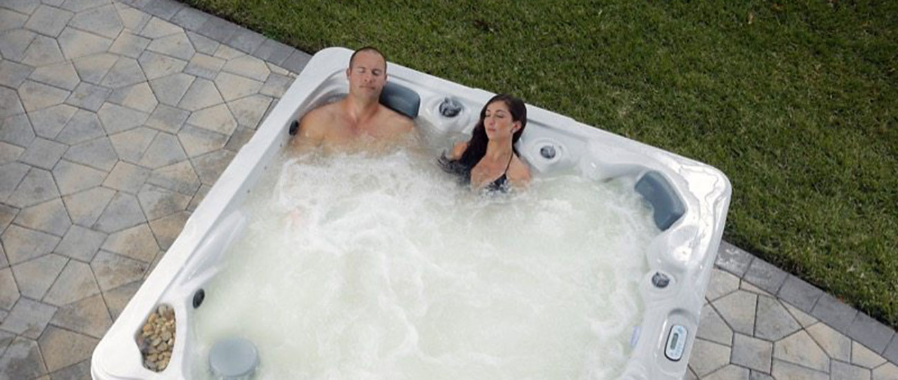 Signature Spas Couple Relaxing Patio Backyard